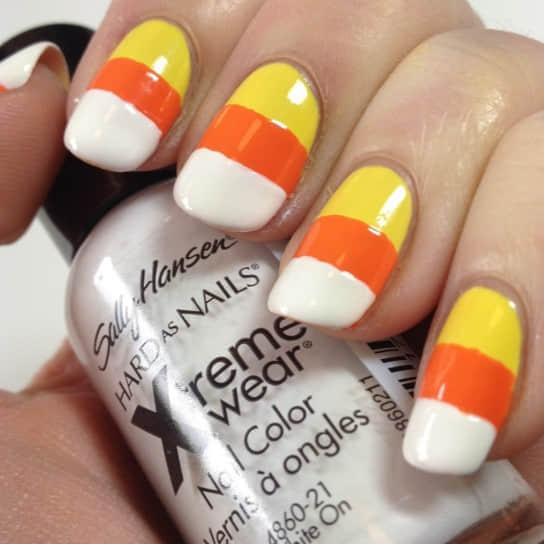 manicure-con-unghie-finte-arancio-e-gialle